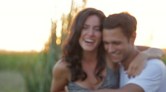 Young couple laughing together outdoors Stock Footage