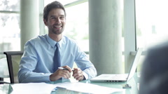 Businessman meeting with client in office Stock Footage