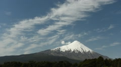 Time lapse view of wispy clouds over Osorno volcano in Chile Stock Footage