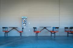 Empty tables at sidewalk cafe, Lone Pine, Inyo County, Onyx, California, USA - stock photo