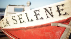Close-up of name painted on side of boat - stock footage