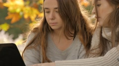 Young high school students working studying for final exam outdoors autumn - stock footage