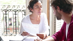 Woman explaining financial document to man Stock Footage