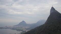 Aerial Christ de Redemer (Cristo Redentor) hills and lake Rio de Janeiro city Stock Footage