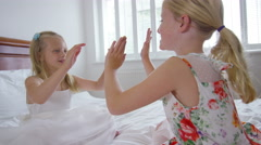 4K 2 Little girls having fun at home, playing in the bedroom Stock Footage