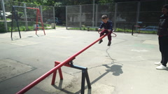 Little Kids Playing on Playground Rocker Stock Footage