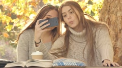 Autumn fall student girls taking selfie photos procrastination while studying Stock Footage