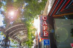 Low angle view of internet cafe sign on street, Santa Monica, Los Angeles, - stock photo