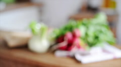 Fennel and radishes on kitchen counter Stock Footage