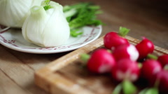 Washed fennel bulbs and radishes Stock Footage
