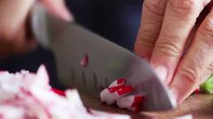 Woman cutting radishes Stock Footage