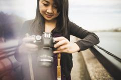 Young woman taking photographs, outdoors Stock Photos