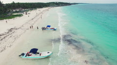 4K Aerial drone shot mexico boat tulum along beach Stock Footage