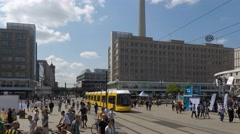 People and traffic on Alexanderplatz in Berlin city centre - time lapse Stock Footage