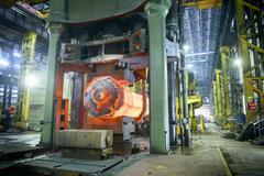 10,000 tonne open die forging press in steelworks Stock Photos