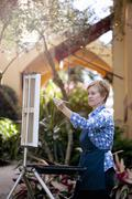 Female artist painting in Albin Polasek Museum and Sculpture Garden, Winter Stock Photos