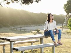 Woman resting on park bench, Roadknight, Victoria, Australia Stock Photos