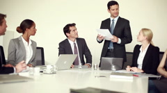 Businessman presenting good news to colleagues at meeting Stock Footage