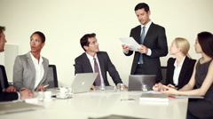 Businessman presenting positive update during meeting - stock footage