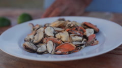 Squeezing lime juice on fresh mussels Stock Footage