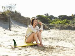 Woman enjoying beach, Roadknight, Victoria, Australia Stock Photos