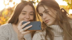 Close up beauty portrait of two attractive teenage girls fun selfie photo Stock Footage
