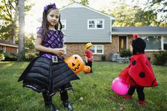 Girl trick or treating Stock Photos