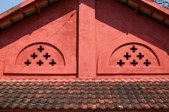 Old red brick gabled roof. - stock photo