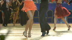 A lot of couples dancing passionate Latin dance in the ballroom. Slow motion. Stock Footage