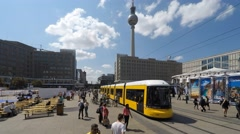 People and traffic on Alexanderplatz in Berlin city center - time lapse Stock Footage
