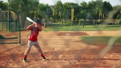 Kid in batting position during baseball practice - stock footage