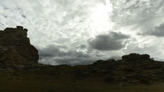 Time lapse shot of clouds moving over rugged landscape Stock Footage
