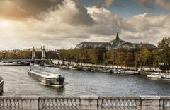 View of river Seine with the Grand Palace in distance, Paris, France Stock Photos