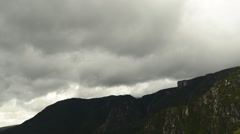 Time lapse shot of low clouds moving over mountains Stock Footage