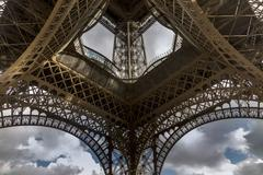 Low angle symmetrical view of Eiffel Tower, Paris, France - stock photo