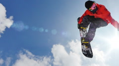 Professional snowboarder doing a backflip slow motion Stock Footage