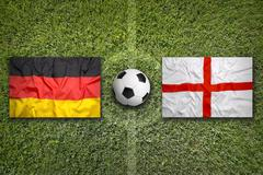 Germany vs. England flags on soccer field Stock Illustration