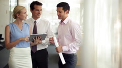 Business associates sharing lighthearted moment during informal meeting - stock footage
