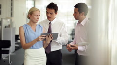 Business colleagues collaborating with use of digital tablet Arkistovideo