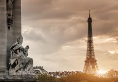 Sculpture on Pont Alexandre III bridge and Eiffel Tower, Paris, France Stock Photos