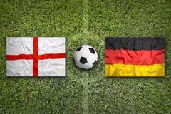 England vs. Germany flags on soccer field - stock illustration