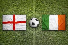 England vs. Ireland flags on soccer field - stock photo