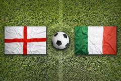 England vs. Italy flags on soccer field - stock photo
