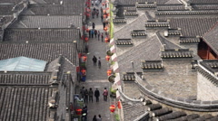 Tourists walking in alley between ancient Chinese architecture Stock Footage