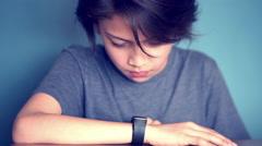 Boy using smartwatch Stock Footage