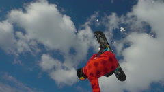 Snowboarder jumping backflip slow motion Stock Footage