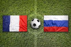 France vs. Russia flags on soccer field - stock illustration