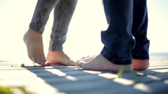 Lovers playing footsies Stock Footage