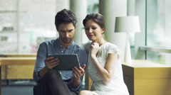 Couple using digital tablet together - stock footage