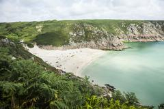 View of holiday makers on beach, Porthcurno, Cornwall, UK - stock photo